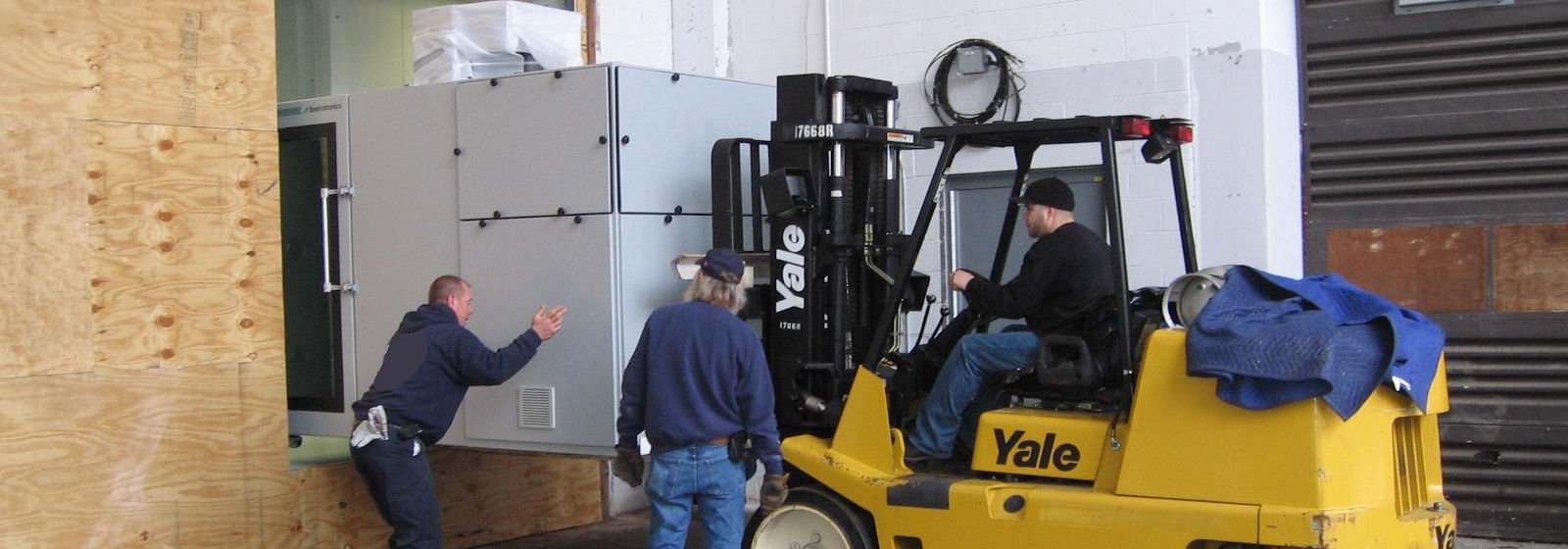 Champagne Logistics shipping team guiding forklift
