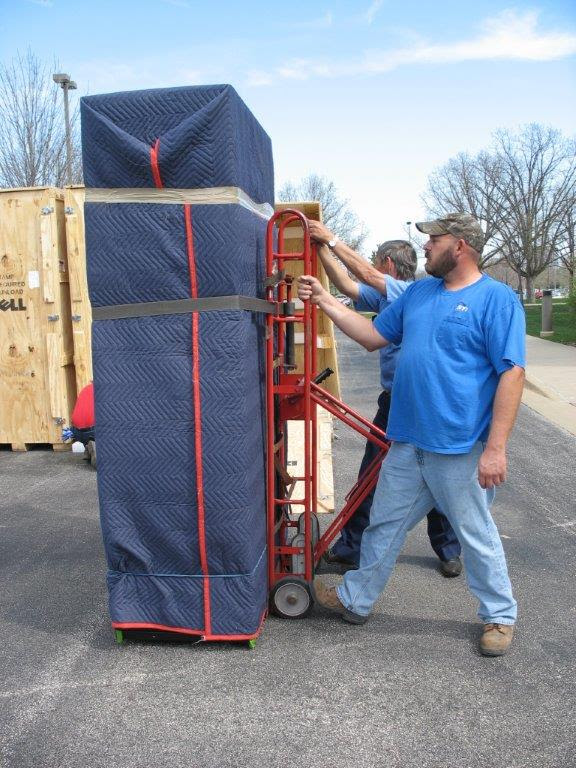 movers with large item on caddy